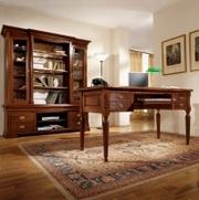 Продается стол и кресло в кожаной обивке.